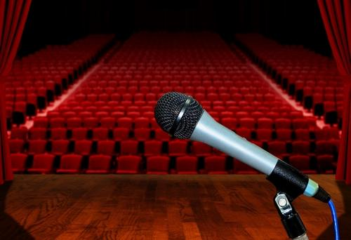 microphone-stage-facing-empty-auditorium-seats