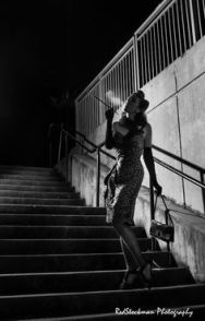 Dame on a dark street